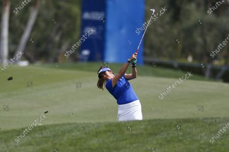 Gerina Piller of United States hits from the fairway to the first hole during the final round of the LPGA's ANA Inspiration golf tournament at Mission Hills Country Club, in Rancho Mirage, Calif
