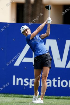 Mel Reid of England watches her shot from the first tee during the final round of the LPGA's ANA Inspiration golf tournament at Mission Hills Country Club, in Rancho Mirage, Calif