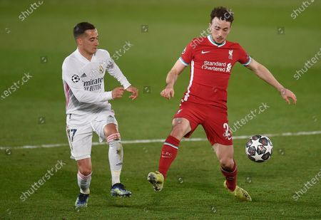 Diogo Jota of Liverpool and Lucas Vazquez of Real Madrid in action