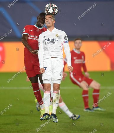 Sadio Mane of Liverpool and Lucas Vazquez of Real Madrid in action