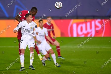 Sadio Mane of Liverpool FC and Lucas Vazquez of Real Madrid