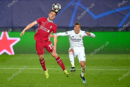 Diogo Jota of Liverpool FC and Lucas Vazquez of Real Madrid
