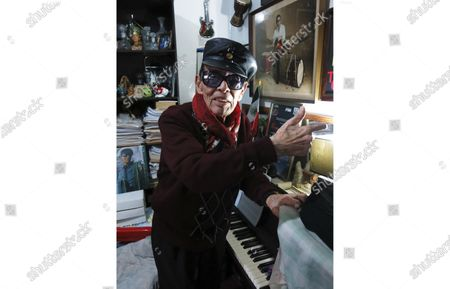 Stock Picture of Mexican jazz player Tino Contreras poses in his studio in Mexico City. Contreras will present a streaming concert from the Casa Azul museum, the old house of Frida Kahlo, on April 10 and 11
