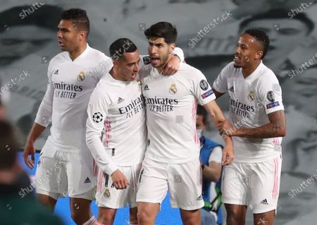 Real Madrid's striker Marco Asensio (2-R) celebrates with teammates Casemiro (R), Lucas Vazquez (2-R) and Eder Militao (R) after scoring the 2-0 goal during the UEFA Champions League quarter final first leg soccer match between Real Madrid and Liverpool FC held at Alfredo Di Stefano stadium, in Madrid, central Spain, 06 April 2021.