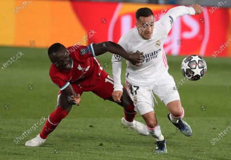 Real Madrid's Lucas Vazquez (R) vies for the ball against Liverpool's winger Sadio Mane (L) during the UEFA Champions League quarter final first leg soccer match between Real Madrid and Liverpool FC held at Alfredo Di Stefano stadium, in Madrid, central Spain, 06 April 2021.