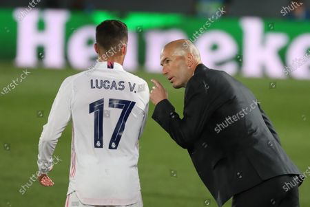 Real Madrid's head coach Zinedine Zidane (R) gives instructions to defender Lucas Vazquez (L) during the UEFA Champions League quarter final first leg soccer match between Real Madrid and Liverpool FC held at Alfredo Di Stefano stadium, in Madrid, central Spain, 06 April 2021.