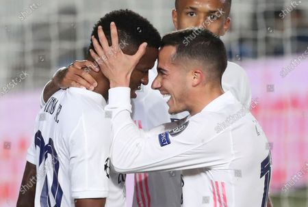 Real Madrid's striker Vinicius Jr (L) celebrates with teammate Lucas Vazquez (R) after scoring the 3-1 goal during the UEFA Champions League quarter final first leg soccer match between Real Madrid and Liverpool FC held at Alfredo Di Stefano stadium, in Madrid, central Spain, 06 April 2021.