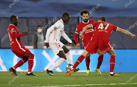 Real Madrid's defender Ferland Mendy (2-L) vies for the ball with Liverpool's striker Mohamed Salah (2-R), defender Nathaniel Phillips (R) and midfielder Naby Keita (L)  during the UEFA Champions League quarter final first leg soccer match between Real Madrid and Liverpool FC held at Alfredo Di Stefano stadium, in Madrid, central Spain, 06 April 2021.