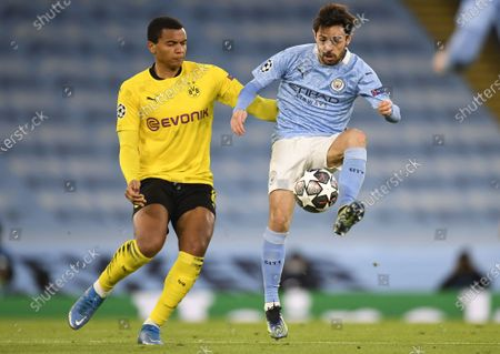 Bernardo Silva (R) of Manchester City in action against Manuel Akanji of Dortmund during the UEFA Champions League quarterfinal, 1st leg soccer match between Manchester City and Borussia Dortmund in Manchester, Britain, 06 April 2021.