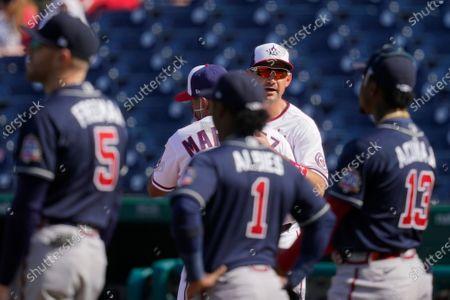 Washington Nationals first baseman Ryan Zimmerman hugs manager Dave Martinez before an opening day baseball game against the Atlanta Braves at Nationals Park, in Washington