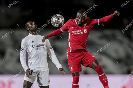 Liverpool's Naby Keita, right, and Real Madrid's Ferland Mendy duel for the ball during the Champions League quarterfinal first leg, soccer match between Real Madrid and Liverpool at the Alfredo di Stefano stadium in Madrid, Spain