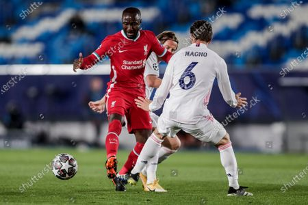 Liverpool's Naby Keita, duels the ball with Real Madrid's Nacho during the Champions League quarterfinal first leg, soccer match between Real Madrid and Liverpool at the Alfredo di Stefano stadium in Madrid, Spain
