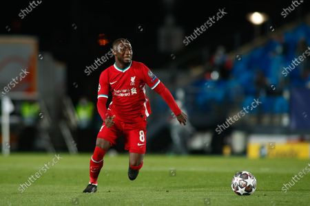 Stock Photo of Naby Keita of Liverpool in action during the UEFA Champions League, Quarter finals round 1, football match played between Real Madrid and Liverpool FC at Alfredo Di Stefano stadium on April 06, 2021 in Valdebebas, Madrid, Spain.