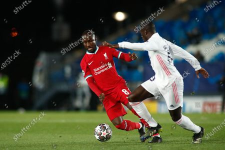 Stock Image of Naby Keita of Liverpool and Ferland Mendy of Real Madrid in action during the UEFA Champions League, Quarter finals round 1, football match played between Real Madrid and Liverpool FC at Alfredo Di Stefano stadium on April 06, 2021 in Valdebebas, Madrid, Spain.
