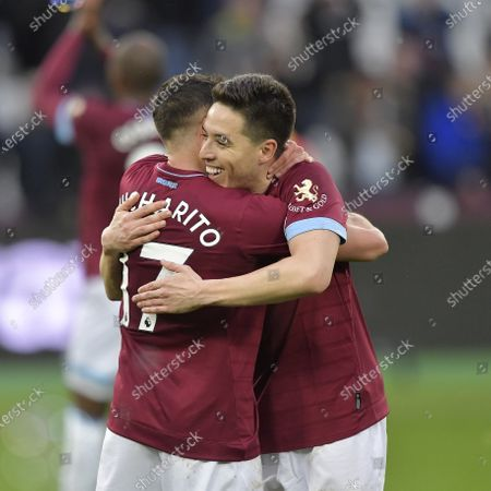 Javier Hernandez of West Ham United celebrates with Samir Nasri (R) following the Premier League match between West Ham United and Huddersfield Town at London Stadium on March 16, 2019 in London, United Kingdom.