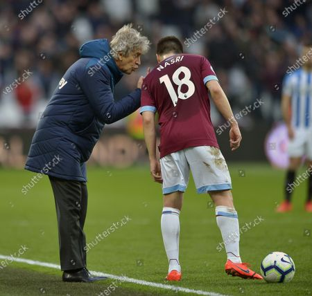 Manuel Pellegrini of West Ham United gives instructions to Samir Nasri during the Premier League match between West Ham United and Huddersfield Town at London Stadium on March 16, 2019 in London, United Kingdom.
