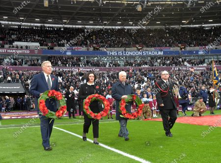 Wreath laying ceremony by Sir Trevor Brooking and David Gold before the Premier League match between West Ham United and Newcastle United at London Stadium on November 2, 2019 in London, United Kingdom.