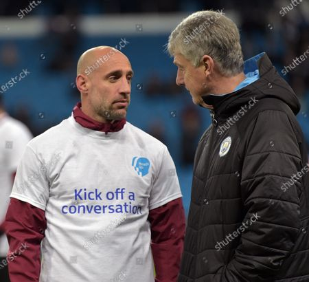 Pablo Zabaleta of West Ham United talks to Brian Kidd of Manchester City prior to the Premier League match between Manchester City and West Ham United at Etihad Stadium on February 19, 2020 in Manchester, United Kingdom.