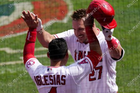 Los Angeles Angels' Mike Trout, right, is congratulated by Jose Iglesias after hitting a two-run home run during the first inning of a baseball game against the Houston Astros, in Anaheim, Calif