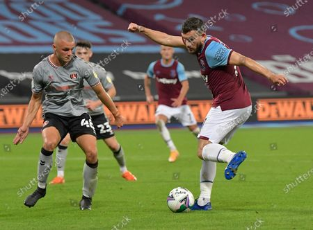 Robert Snodgrass of West Ham United in action with Charlie Barker of Charlton Athletic during the Carabao Cup Second Round match between West Ham United and Charlton Athletic at London Stadium on September 15, 2020 in London, England.