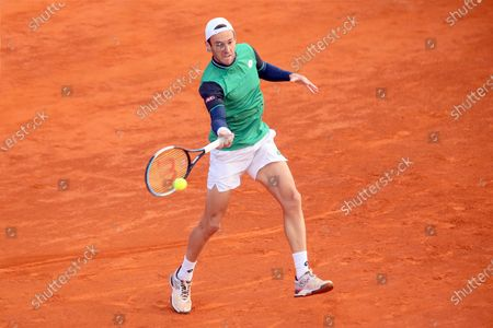 Stock Photo of Stefano Travaglia in action during the ATP Tour 250 Sardegna Open tennis match in Cagliari, Italy on April 06, 2021.