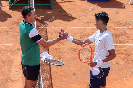 Federico Coria greets John Millman after their ATP Tour 250 Sardegna Open tennis match in Cagliari, Italy on April 06, 2021.