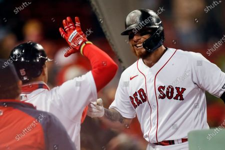 Boston Red Sox's Christian Vazquez celebrates his solo home run during the ninth inning of a baseball game against the Tampa Bay Rays, in Boston
