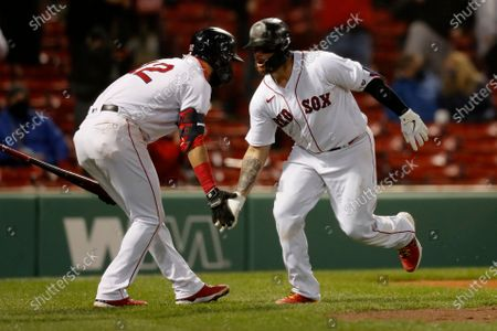 Boston Red Sox's Christian Vazquez celebrates his solo home run with Marwin Gonzalez (12) during the ninth inning of a baseball game against the Tampa Bay Rays, in Boston