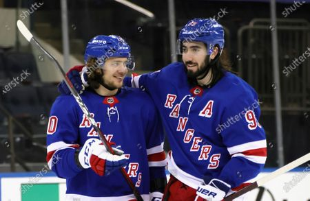 New York Rangers' Artemi Panarin, left, and Mika Zibanejad celebrate the team's 8-4 victory over the Pittsburgh Penguins in an NHL hockey game, in New York