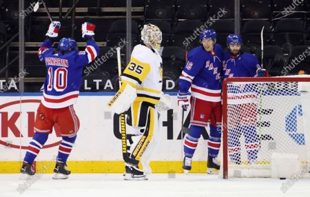 New York Rangers' Colin Blackwell, right, celebrates his goal against Pittsburgh Penguins' Tristan Jarry (35), and is joined by Artemi Panarin, left, and Ryan Strome (16) during the first periodof an NHL hockey game, in New York