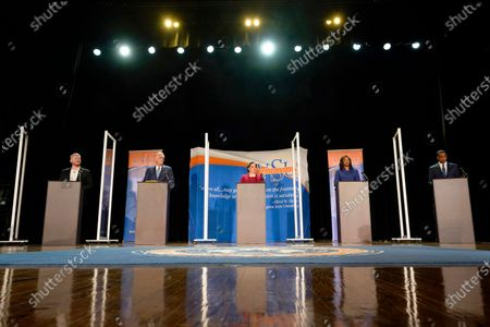 Democratic candidates for Governor of Virginia, Del. Lee Carter, left, former Gov., Terry McAuliffe, second from left, state Sen. Jennifer McClellan, center, Del. Jennifer Carroll Foy, second from right, and Virginia Lt. Gov. Justin Fairfax, right, prepare for a debate at Virginia Sate University in Petersburg, Va
