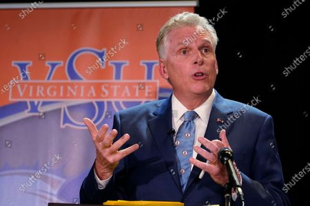 Democratic candidate for Governor of Virginia former Gov., Terry McAuliffe gestures during a debate at Virginia State University in Petersburg, Va
