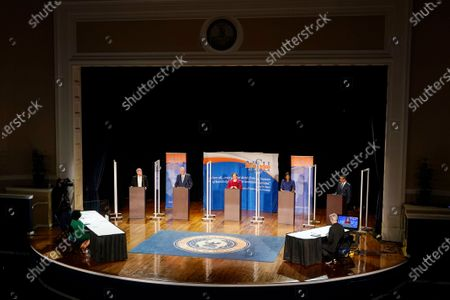 Democratic candidates for governor of Virginia, Del. Lee Carter, left, former Gov. Terry McAuliffe, second from left, state Sen. Jennifer McClellan, center, Del. Jennifer Carroll Foy, second from right, and Virginia Lt. Gov. Justin Fairfax, right, participate in a debate at Virginia State University in Petersburg, Va