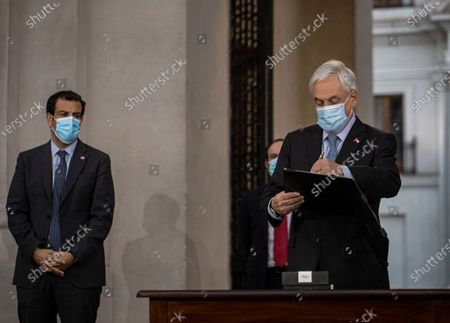 Chile's President Sebastian Pinera signs the constitutional reform that postpones the next elections for constitutional delegates, mayor's and regional elections for May 15 and 16, due to the COVID-19 pandemic, at a La Moneda presidential palace in Santiago, Chile