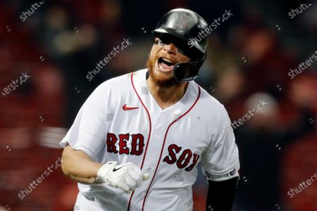 Boston Red Sox's Christian Vazquez reacts after hitting a solo home run during the ninth inning of the team's baseball game against the Tampa Bay Rays, in Boston