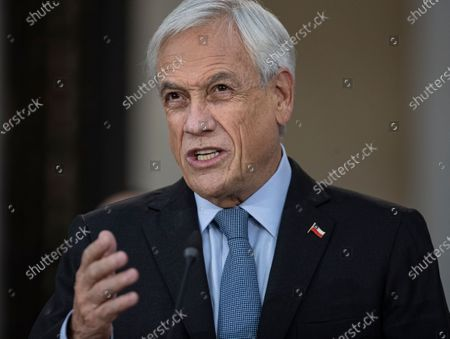 Chile's President Sebastian Pinera speaks before signing the constitutional reform that postpones the next elections for constitutional delegates, mayor's and regional elections for May 15 and 16, due to the COVID-19 pandemic, at a La Moneda presidential palace in Santiago, Chile