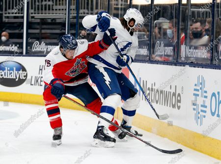 Columbus Blue Jackets defenseman Michael Del Zotto, left, works against Tampa Bay Lightning forward Pat Maroon during the first period of an NHL hockey game in Columbus, Ohio