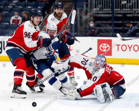 Columbus Blue Jackets goalie Joonas Korpisalo (70) stops a shot in front of Tampa Bay Lightning forward Tyler Johnson and Blue Jackets forward Jack Roslovic (96) and defenseman David Savard (58) during the third period an NHL hockey game in Columbus, Ohio