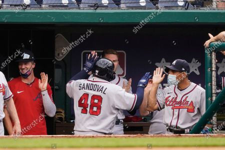 Atlanta Braves' Pablo Sandoval, right, celebrates his two-run homer with his teammates during the seventh inning of the second baseball game of a doubleheader against the Washington Nationals at Nationals Park, in Washington. The Braves won the second game 2-0