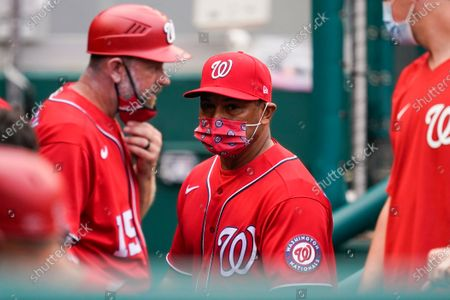 Stock Photo of Washington Nationals manager Dave Martinez, center, walks in the dugout during the sixth inning of the second baseball game of the team's doubleheader against the Atlanta Braves at Nationals Park, in Washington. The Braves won 2-0