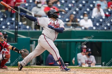 Atlanta Braves' Pablo Sandoval watches his two-run home run during the seventh inning of the second baseball game of the team's doubleheader against the Washington Nationals at Nationals Park, in Washington. The Braves won 2-0