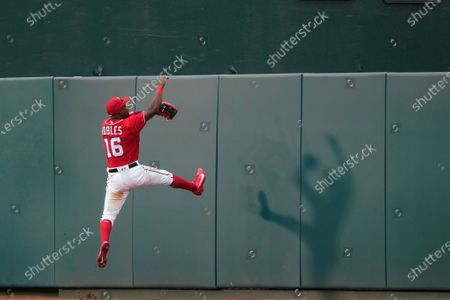 Washington Nationals center fielder Victor Robles jumps to the wall but can't catch a two-run home run hit by Atlanta Braves' Pablo Sandoval during the seventh inning of the second baseball game of a doubleheader at Nationals Park, in Washington. The Braves won 2-0