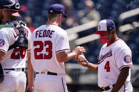 Stock Picture of Washington Nationals starting pitcher Erick Fedde is relieved by manager Dave Martinez (4) during the second inning of the first baseball game of a baseball doubleheader against the Atlanta Braves, at Nationals Park, in Washington