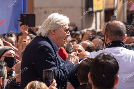Stock Picture of Vittorio Sgarbi speaks during demonstration organized by some organizations of restaurant owners and shop owners in front of Montecitorio Palace in Rome