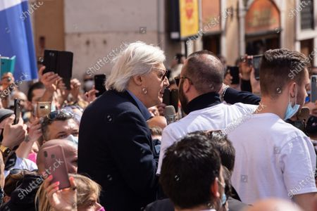 Stock Image of Vittorio Sgarbi speaks during demonstration organized by some organizations of restaurant owners and shop owners in front of Montecitorio Palace in Rome