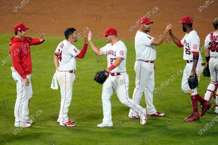 The Los Angeles Angels celebrate after a win over the Houston Astros during a baseball game, in Anaheim, Calif