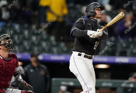 Colorado Rockies' Ryan McMahon follows the flight of his solo home run off Arizona Diamondbacks starting pitcher Luke Weaver in the second inning of a baseball game, in Denver