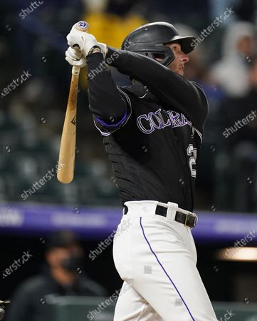 Stock Picture of Colorado Rockies' Ryan McMahon follows the flight of his solo home run off Arizona Diamondbacks starting pitcher Luke Weaver in the fourth inning of a baseball game, in Denver