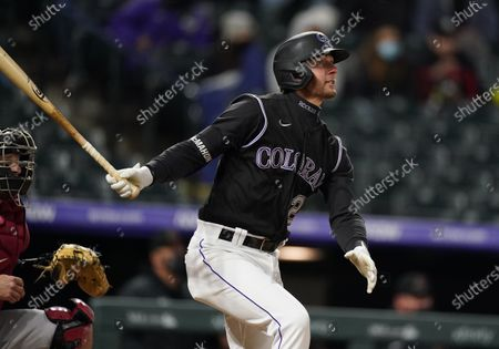 Stock Picture of Colorado Rockies' Ryan McMahon follows the flight of his solo home run off Arizona Diamondbacks starting pitcher Alex Young in the seventh inning of a baseball game, in Denver