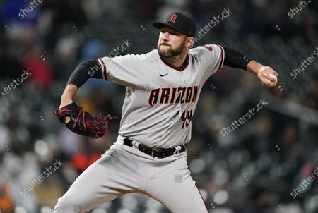 Arizona Diamondbacks starting pitcher Alex Young works against the Colorado Rockies in the seventh inning of a baseball game, in Denver